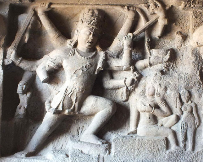 Figure 1. This 5th century carving from India's Ellora caves shows the god, Shiva, in Warrior Pose with his wife, Parvati.