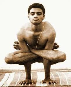The famous Ashtanga teacher, Sharath Jois, in a Kukkutasana.