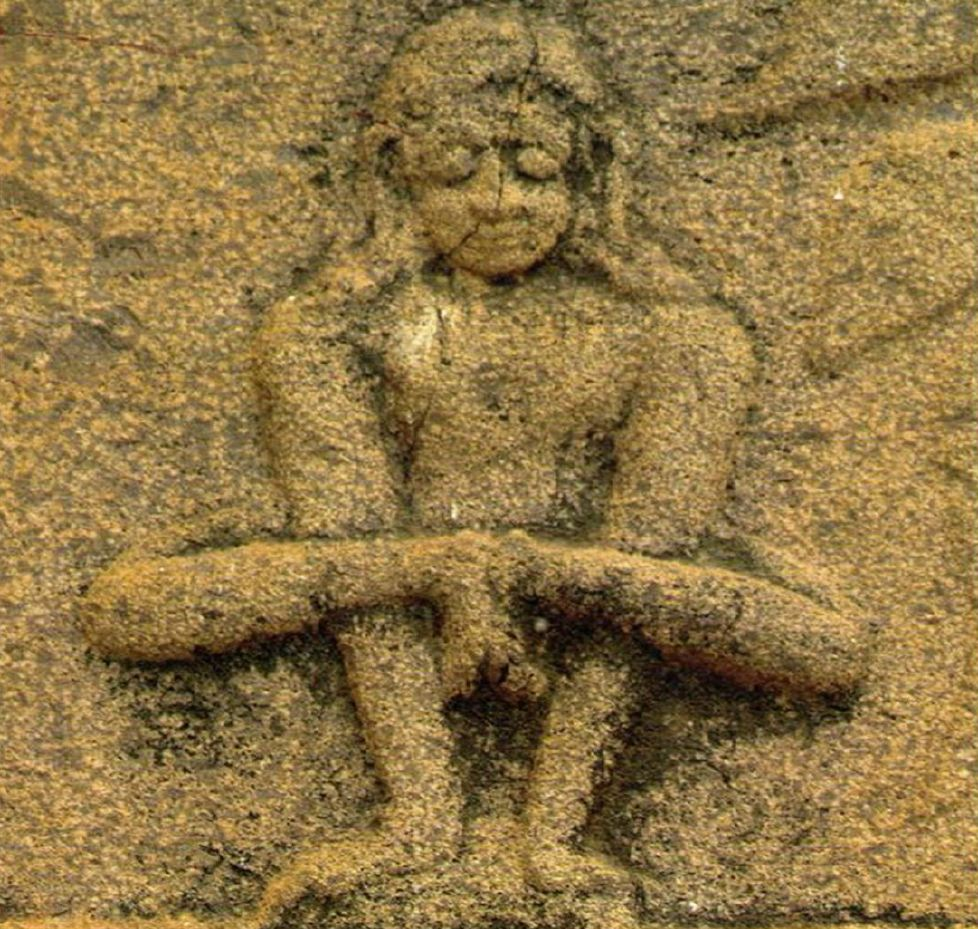 Figure 1. A wall-carving from the year 1510 in a temple found in Sri Sailam, India that shows a yogi in Kukkutasana